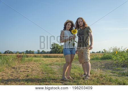 Young happy and romantic caucasian couple at countryside background