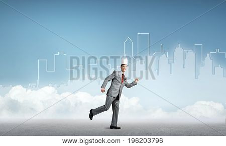 Young handsome businessman wearing white paper crown running in a hurry