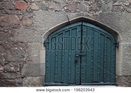 a large door in the old stone wall 1