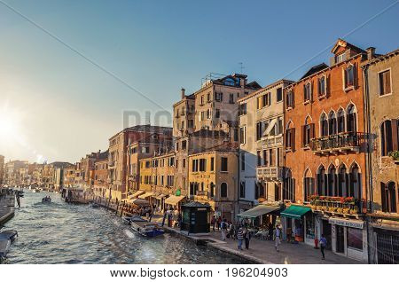 Venice, Italy - May 08, 2013. View of buildings and boats in front of the Canal Grande at the sunset in Venice, the historic and amazing marine city. Veneto region, northern Italy. Retouched photo