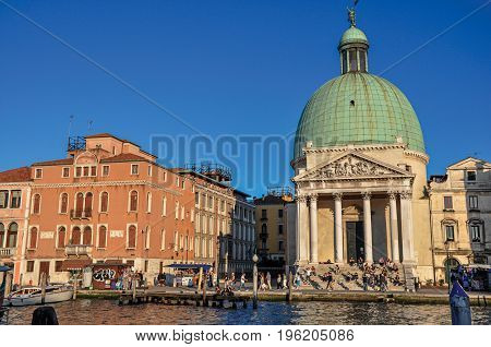 Venice, Italy - May 08, 2013. Overview of the San Simeone Piccolo Church, in front of the Canal Grande at the sunset in Venice, the historic and amazing marine city. Veneto region, northern Italy