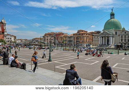 Venice, Italy - May 09, 2013. Square view across the Grand Canal with the San Simeone Piccolo Church at the city of Venice, the historic and amazing marine city. Veneto region, northern Italy