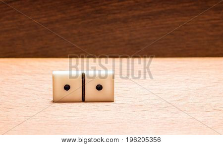 Dice for playing dominoes on a wooden background