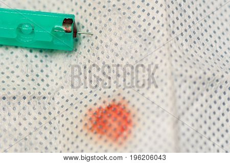 Used Scarifier Alcohol-a Cloth With Blood Stain For Take Blood Probe. Closeup