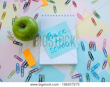 Close Up Of A Apple Resting On A Blank Lined Notebook