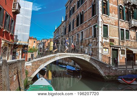Venice, Italy - May 09, 2013. View of buildings and bridge in front of a canal in a sunny day. At  the city center of Venice, the historic and amazing marine city. Veneto region, northern Italy