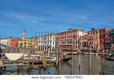 Venice, Italy - May 09, 2013. Overview of buildings, piers and gondolas in front of the Canal Grande in the city center of Venice, the historic and amazing marine city. Veneto region, northern Italy