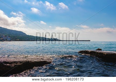 View from the sea to commercial port and balchik town on black sea coast Bulgaria.