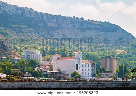 Cityscape of balchik town houses and buildings on shore of black sea coast Bulgaria.