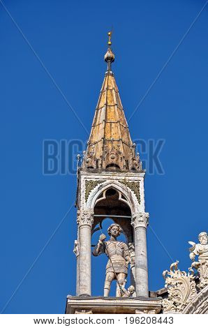 Close-up of marble sculptures and tower in typical Venetian style on the San Marco Basilica. At the city of Venice, the historic and amazing marine city. Located in Veneto region, northern Italy