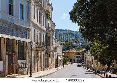View of the street in balchik town road and old historic houses in Bulgaria.
