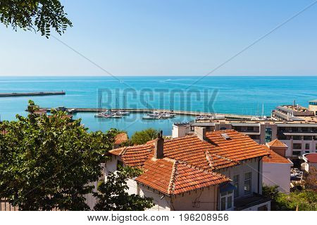 Seascape view from altitude above houses to the sea with blue turquoise water in Balchik city black sea coast in Bulgaria.