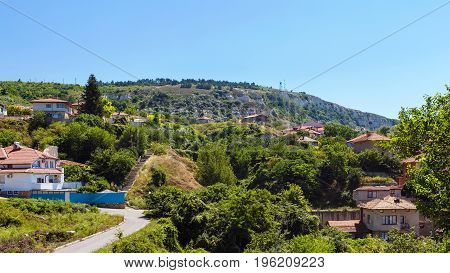 Cityscape of balchik town houses on green hill black sea coast in Bulgaria.