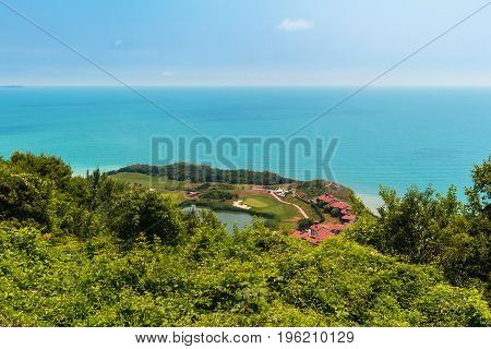 Seascape view from altitude to the sea with blue turquoise water at the sunny summer day.