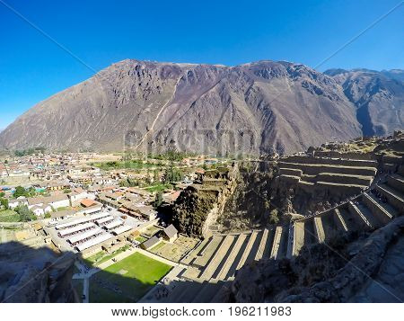 Top view of Ollataytambo fortress in Sacred Valley near Cusco, Peru. Light and shadow in the valley
