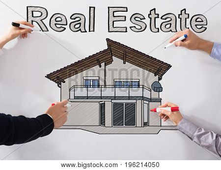 Hands Drawing Real Estate Drawing With Different Marker On White Background