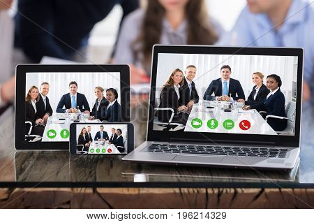Video Conferencing On Modern Electronic Devices Over The Office Desk