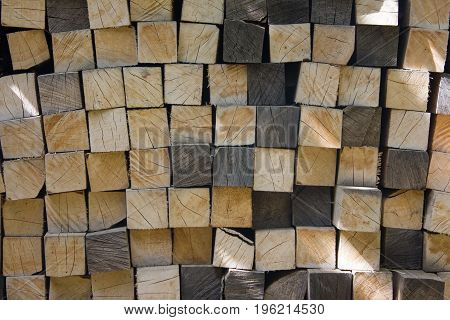 A pile of square firewood on a sunny day. Square firewood