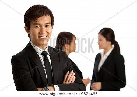 Asian Business Man With Colleague's In Background