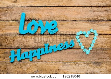 Love And Happiness - Blue Turquoise Wooden Words With Heart Shape On Wooden Background