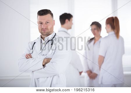 Portrait Of Confidence Professional Male Doctor With Stethoscope