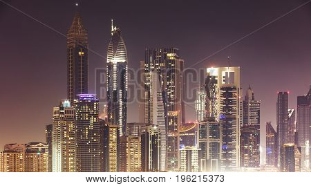 Illuminated Dubai Skyline At Night Against Sky