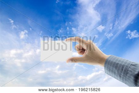 hand with name card on sky background concept business