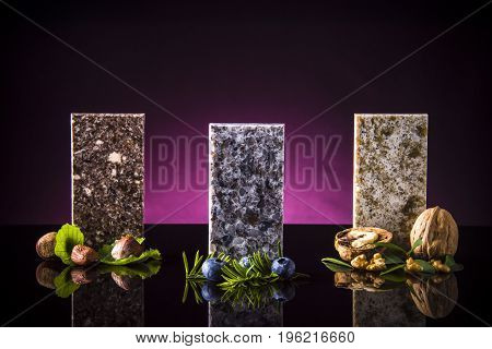 Colorful kitchen granite countertops squares on black surface with natural plants colors, Granite countertops. Kitchen granite countertops color samples. Modern kitchen countertops. Colorfull kitchen granite countertops squares. Countertops concept. Grani