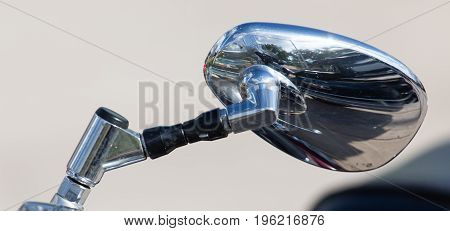 Chromed mirror on motobike as a detail