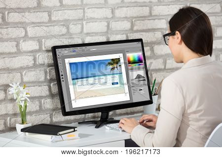 Close-up Of A Creative Young Woman Working On Computer In Office