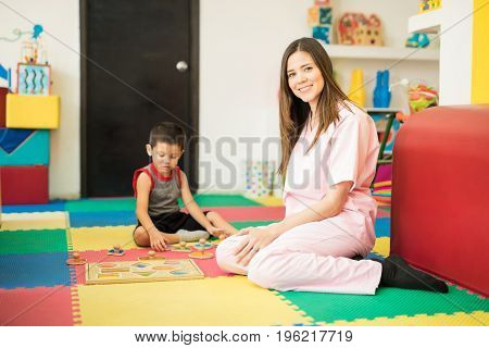Cute Therapist Working With A Boy