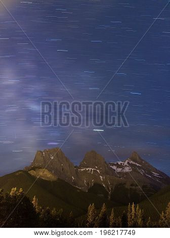 Star Trails and the Milky Way Over the Three Sisters Mountain Range, Canmore, Alberta, Canada