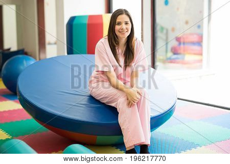 Portrait of a gorgeous young Hispanic children therapist in a early stimulation and development center
