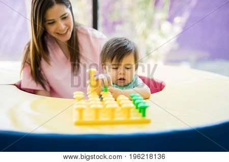 Baby And Therapist Playing With Toys