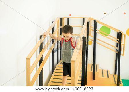 Cute Kid Walking Down A Ramp