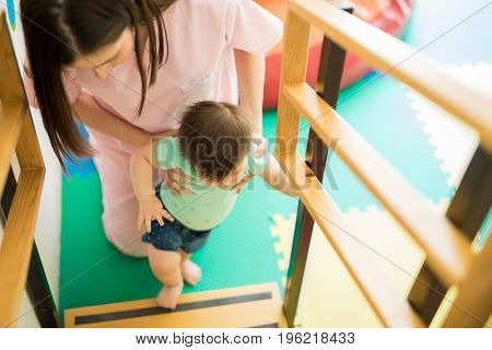 Baby Climbing Stairs With Some Help