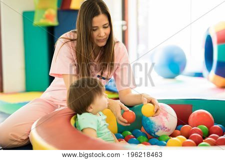 Baby Having Fun In Ball Pool