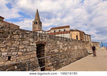 POREC CROATIA - JULY 14: Belltower of the Euphrasian Basilica in Porec on July 14 2017