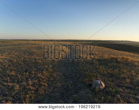 Walking down a Path in Grasslands National Park, Saskatchewan, Canada at Sunset