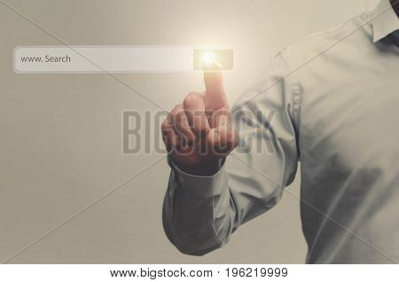 businessman search button on virtual touch screen pressed with finger vintage soft focus picture concept
