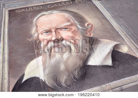 PISA ITALY - JANUARY 23 2016: Street art sidewalk chalk portrait of Galileo Galilei. In Italy pavement artists can transform ordinary sidewalks in real works of art.