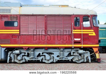 Cabin Of Modern Russian Electric Train. Side View Of The Head Of Railway Train With A Lot Of Wheels