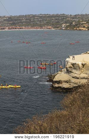 LA JOLLA, CALIFORNIA/USA - JULY 15, 2017:  Tourists and residents riding kayaks and scuba diving as summer activities in La Jolla, California