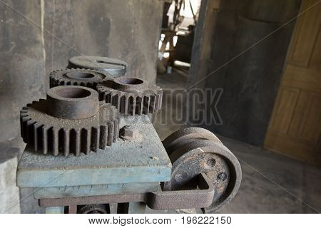 Vintage Cogs On Dirty Machinery In Factory