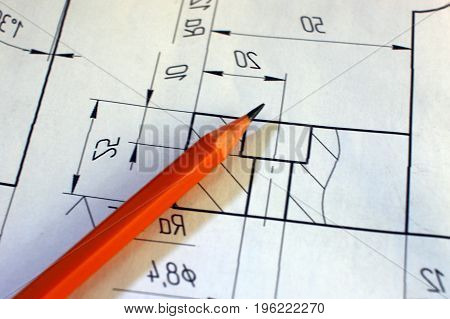 Open drawings with a pencil. Engineering and design. Construction projects. Planning.