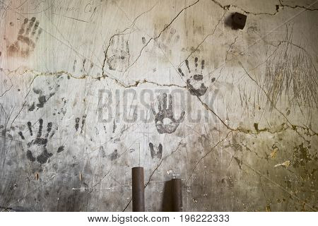 Handprints On Concrete Wall With Pipes