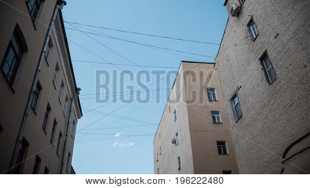St Petersburg courtyards. Houses are connected by a web of wires. From below