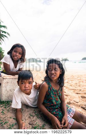 EL NIDO PALAWAN PHILIPPINES - JANUARY 20 2017: Vertical picture of filipino children posing to the camera at Nacpan Beach Philippines.