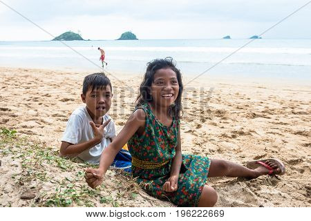 EL NIDO PALAWAN PHILIPPINES - JANUARY 20 2017: Horizontal picture of local boy and girl at Nacpan Beach Philippines.