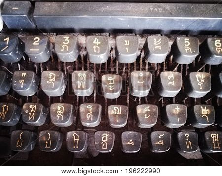Close up picture of Thai language on Thai typewriter keyboard.